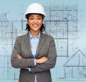 Businesswoman in white helmet with crossed arms Royalty Free Stock Images