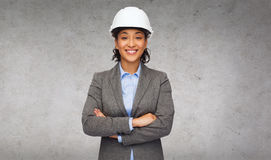 Businesswoman in white helmet with crossed arms Stock Photos