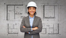 Businesswoman in white helmet with crossed arms Stock Photo
