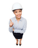 Businesswoman in white helmet with finger up Stock Photo