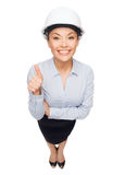 Businesswoman in white helmet showing thumbs up Royalty Free Stock Photography