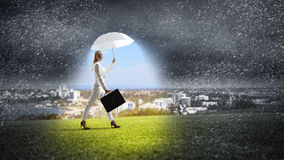 Businesswoman with white umbrella Royalty Free Stock Images