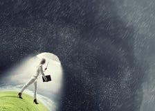 Businesswoman with white umbrella . Mixed media Royalty Free Stock Image