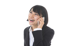 Businesswoman who talks on the tele Stock Photo