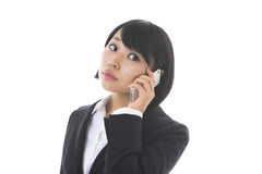 Businesswoman who talks on the tele. The Young businesswoman who talks on the telephone Royalty Free Stock Photos
