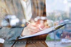 A businesswoman will analyze the chart statistics . royalty free stock photo