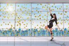 Businesswoman in winner posture under money rain royalty free stock photography