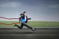 Businesswoman winning a business race Stock Images