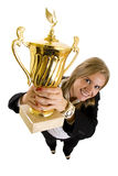 Businesswoman winning a gold trophy. Wide angle picture of an attractive businesswoman winning a gold trophy Stock Photos