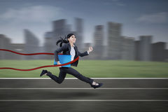Businesswoman winning on a race Royalty Free Stock Photos
