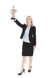 Businesswoman winning a trophy. Isolated on white Stock Photos