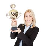 Businesswoman winning a trophy. Isolated on white Stock Photo