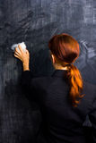 Businesswoman wiping her slate clean Stock Photography