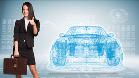 Businesswoman and wire-frame car. Businesswoman holding briefcase and showing thumb up. Wire-frame car and high-tech graphs as backdrop Royalty Free Stock Photography
