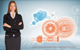 Businesswoman with wire frame gears Stock Images