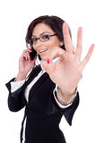 Businesswoman With Phone And Ok Gesture Stock Photos