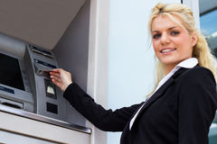 Businesswoman withdrawing money from credit card Royalty Free Stock Photo