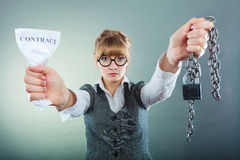 Businesswoman woman ending breaking contract. Businesswoman woman ending agreement deal. Young girl holding chain breaking free creasing squeezing paper royalty free stock images