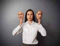 Businesswoman woman holding two masks Stock Image