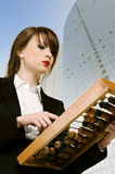 Businesswoman with wooden abacus Stock Images