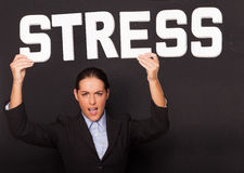 Businesswoman with the word STRESS Stock Photo