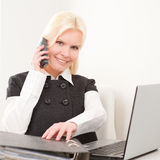 Businesswoman at work. Young and beautiful business woman at work Stock Images