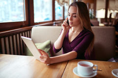 Businesswoman work in cafe Stock Photos