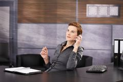 Businesswoman on work call Stock Image