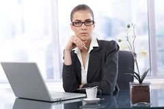 Businesswoman at work having coffee Stock Image