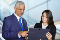 Businesswoman At Work With Senior Client Stock Photos