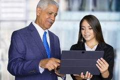 Businesswoman At Work With Senior Client Royalty Free Stock Images