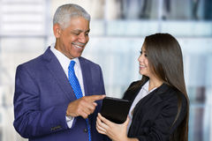 Businesswoman At Work With Senior Client Stock Images