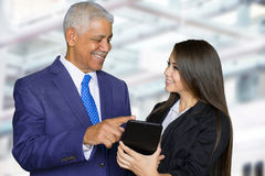 Businesswoman At Work With Senior Client Royalty Free Stock Image