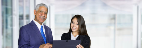 Businesswoman At Work With Senior Client Stock Photo