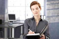 Businesswoman at work taking notes Royalty Free Stock Images