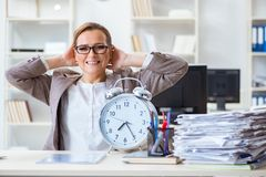 The businesswoman workaholic trying to finish urgent paperwork. Businesswoman workaholic trying to finish urgent paperwork Stock Photos