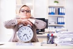 The businesswoman workaholic trying to finish urgent paperwork. Businesswoman workaholic trying to finish urgent paperwork Royalty Free Stock Images