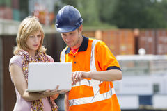 Businesswoman and worker with laptop Royalty Free Stock Images