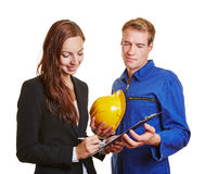 Businesswoman with worker signing Stock Images