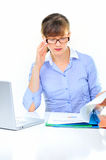 Businesswoman is working. Businesswoman is checking an annual report Royalty Free Stock Image