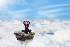 Businesswoman working above clouds Stock Photography