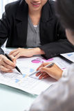 Businesswoman working and analyzing Stock Photography