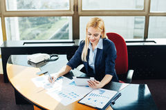 Businesswoman in the working atmosphere Stock Image