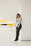 Businesswoman on working break calling on cellphone Stock Photography