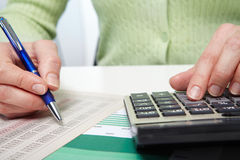 Businesswoman working with calculator Royalty Free Stock Photography