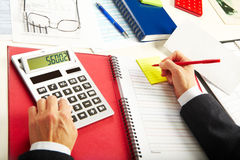 Businesswoman working with calculator Royalty Free Stock Photos