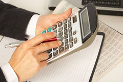 Businesswoman working with calculator Stock Photo