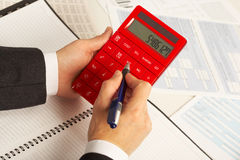 Businesswoman working with calculator Stock Photography