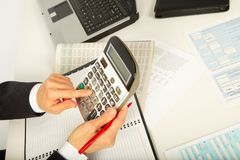 Businesswoman working with calculator Royalty Free Stock Image