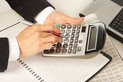 Businesswoman working with calculator Royalty Free Stock Photo